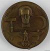 Museum Wolmirstedt. (2018-05-16). Abzeichen zum 1. Mai 1934. Retrieved from https://st.museum-digital.de/index.php?t=objekt&oges=43084